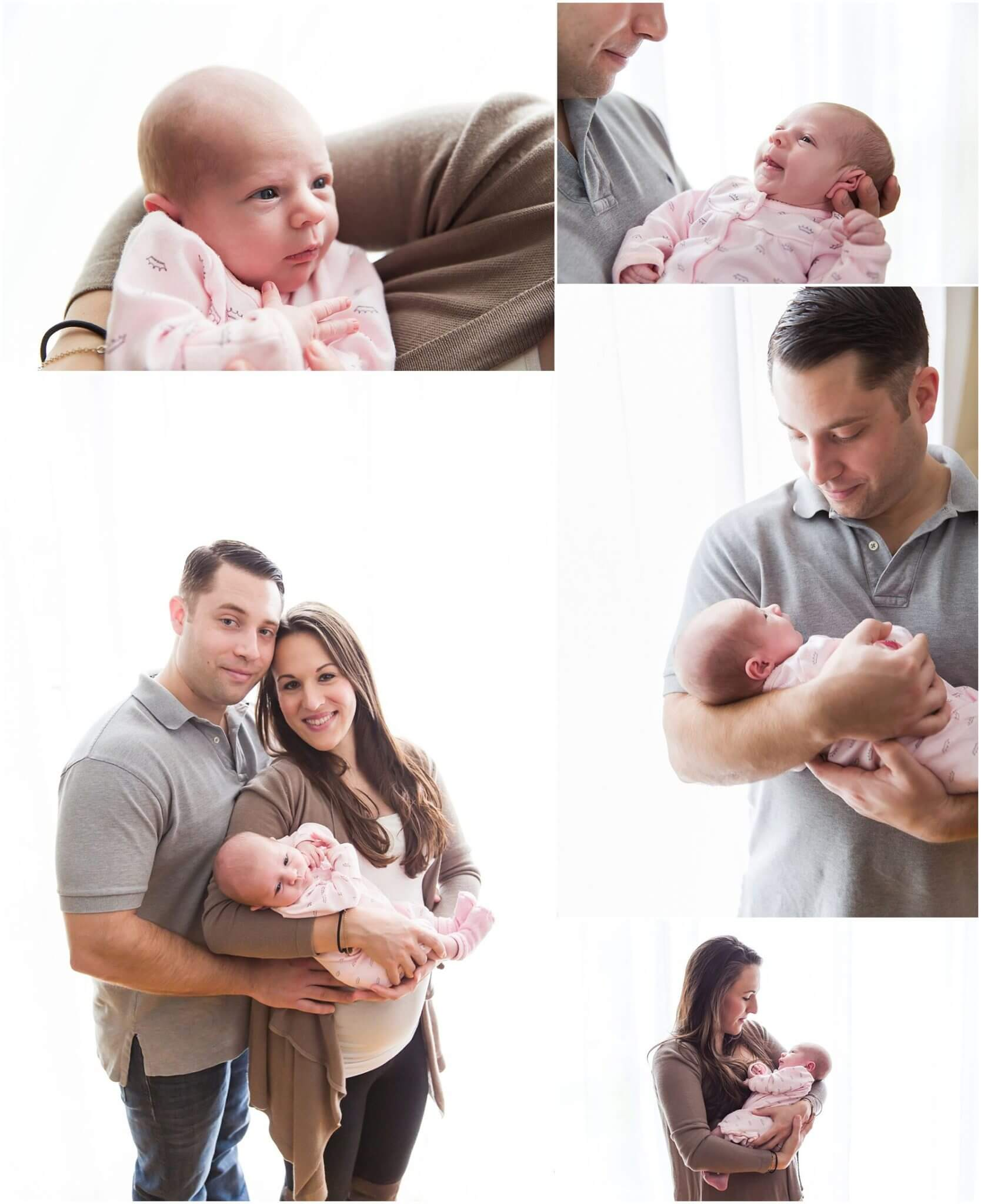 lifestyle newborn session. family holding newborn baby girl using large window as softbox backlighting them.