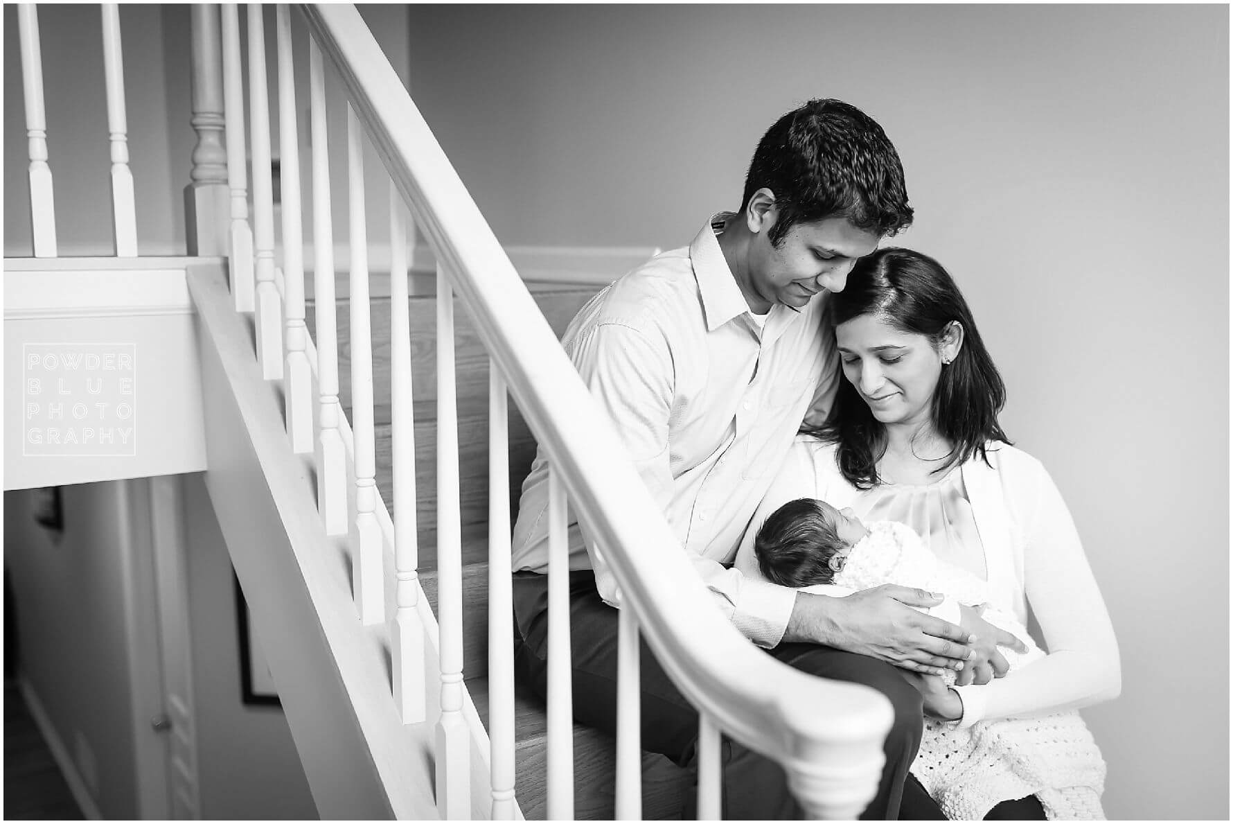 pittsburgh newborn photographer lifestyle photography session. newborn baby in black & white and color portraits on a bed in a home.